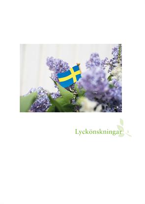 Bild på Hyllningsblad utlandskyrkan syrener med flagga