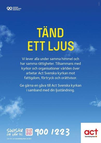 Bild på Ljusbärarskylt stående. Act Svenska kyrkan